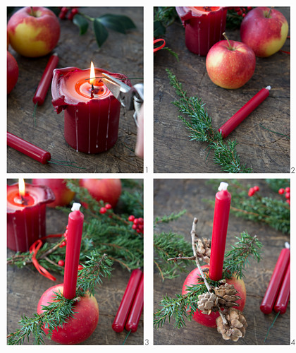 Decorating Christmas apples with candles, larch cones and juniper sprigs