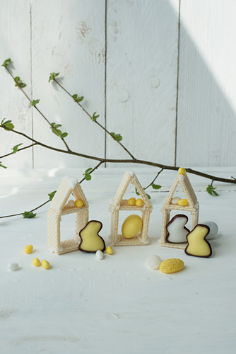Houses made from wafer biscuits, Easter bunnies and Easter eggs