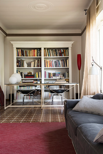 Work area with classic bookcases in living room
