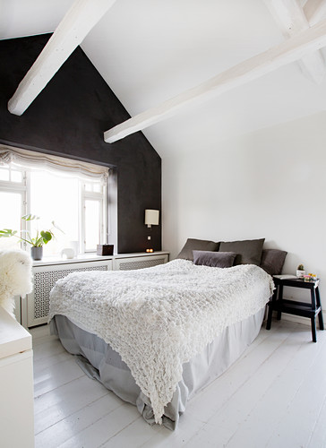 Attic bedroom with black gable-end wall