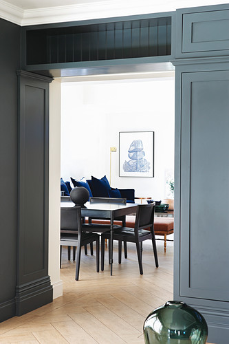 Open doorway with grey panelling leading into living area