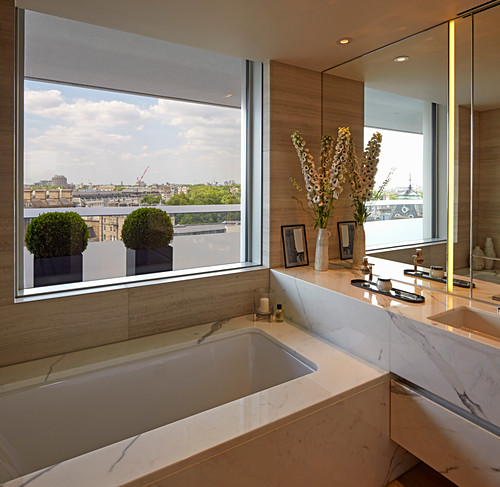 Luxurious bathroom with marble cladding and view of London