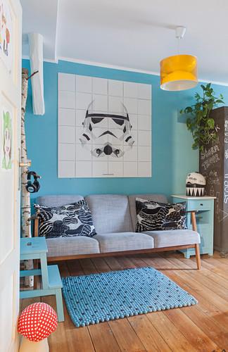 Star Wars image on tiles on light blue wall above retro sofa