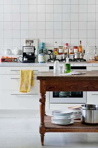 Wooden table used as additional worksurface in kitchen