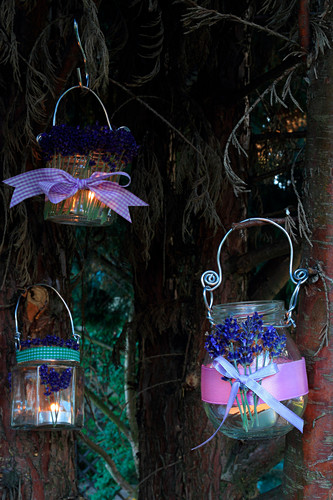 Handmade candle lanterns decorated with scented lavender