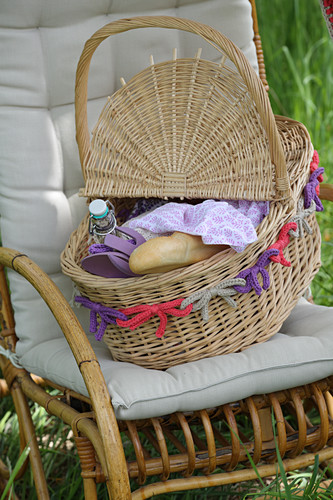Picnic basket with border of crocheted bows