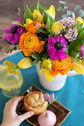A colourful bouquet with buttercups, anemones and tulips