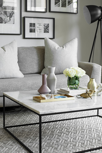 Feminine ornaments on delicate coffee table with marble top