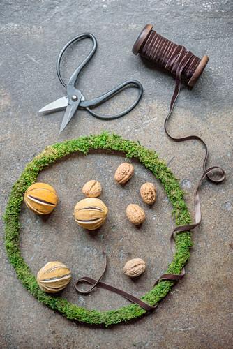 Dried orange pomanders and walnuts in narrow wreath of moss