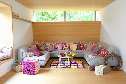 Colourful cushions on grey sofa in modern living room