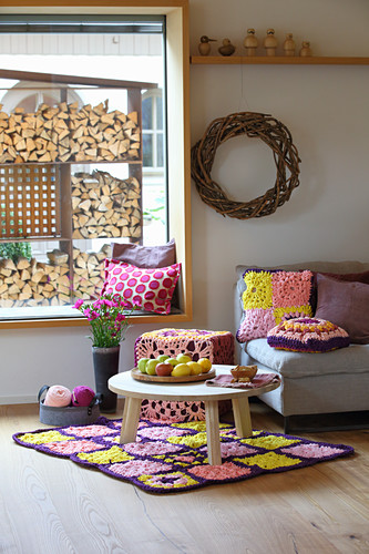 Crocheted home textiles in country-house-style living room