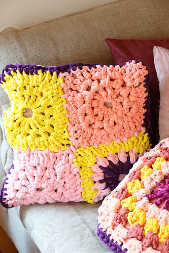 Cushions made from crocheted jersey granny squares in pink and yellow