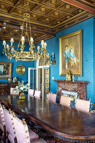 Long table and coffered ceiling in opulent dining room