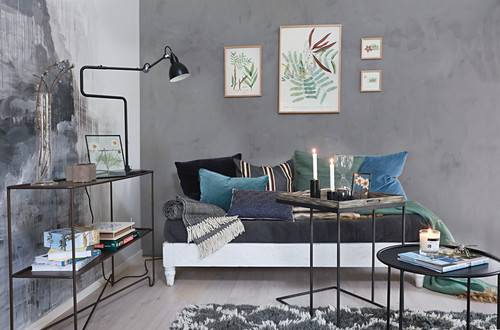 Living room with grey-painted walls and blue-green accessories