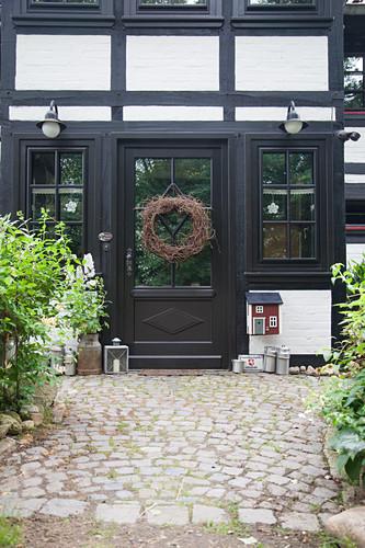 Wreath of front door of half-timbered house