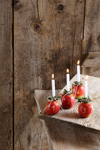 Four apples used as Advent candle holders