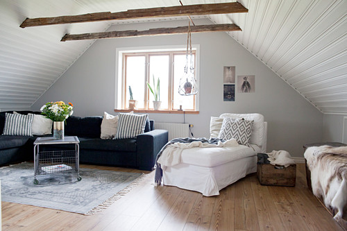 Cosy attic living room with panelled ceiling