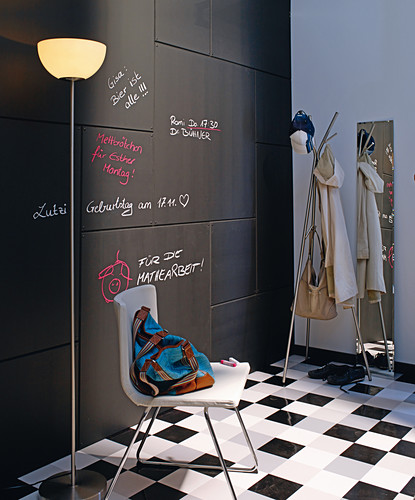 Wall clad in chalkboard panels in hallway