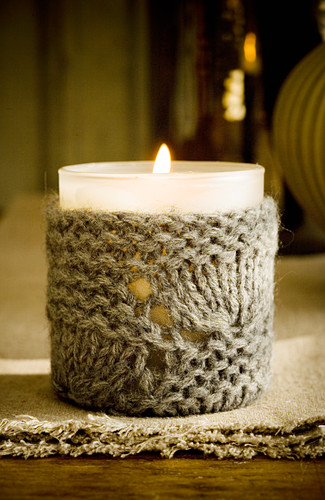 Votive candle lantern with knitted cover