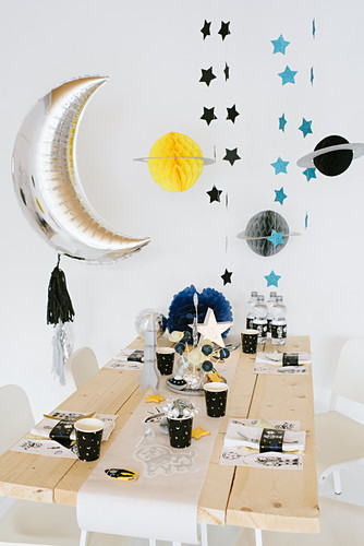Space party: table festively set for child's birthday party