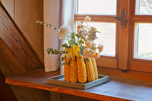 Vase made from corn cobs on windowsill