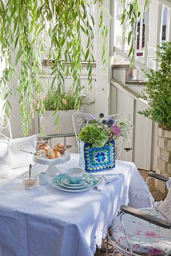 Crocheted ornament on romantic garden table set for tea