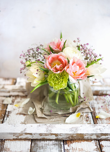 Bunch of flowers in vase (carnation, ranunculus, tulip)