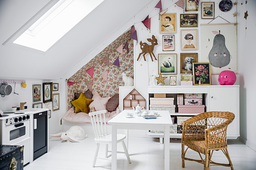 Cosy seating corner in niche in girl's attic bedroom