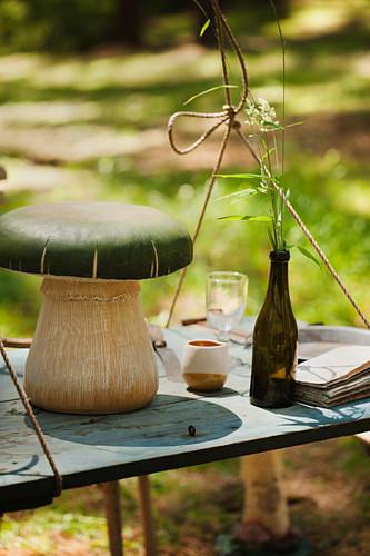Mushroom ornament on suspended table outdoors