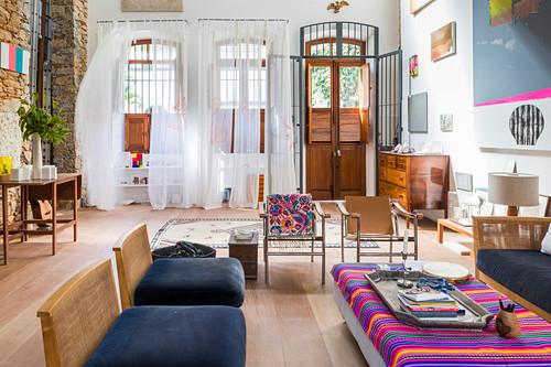 Three large, open terrace doors in artistic living room