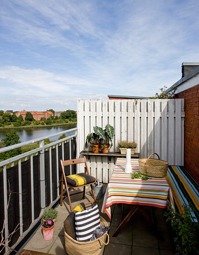 Striped patterns on table, bench and cushions on balcony