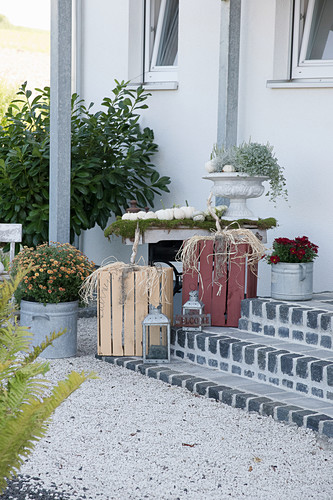 Autumnal arrangement with wooden crates made into pumpkins