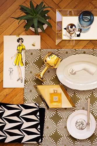Mood board with plates, goblet and perfume bottle