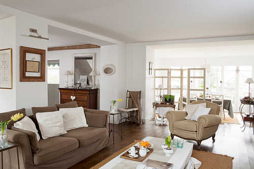 Country-house-style, open-plan interior in shades of brown