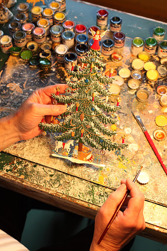 Hand-painted pewter Christmas tree in workshop