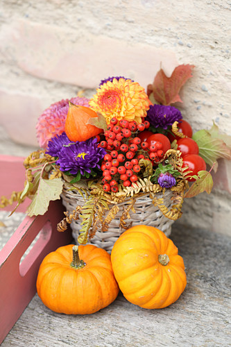 Rustic autumn arrangement of flowers and pumpkins