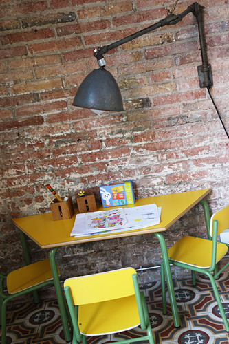 Industrial lamp above children's table and chairs