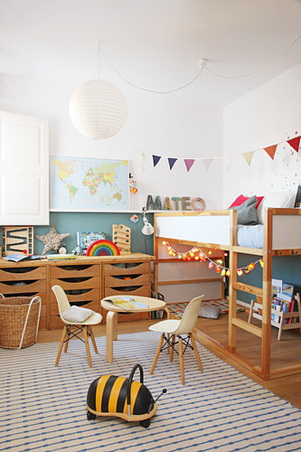 Wooden furniture in child's bedroom with two-tone walls