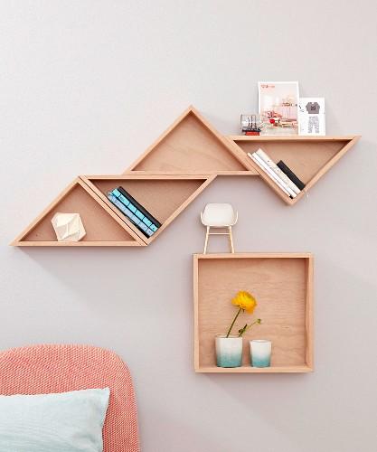 Homemade tangram-style wall shelves