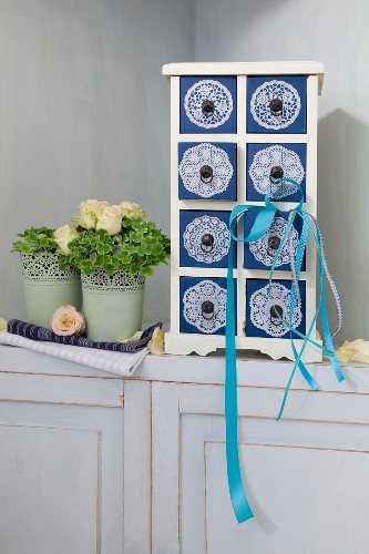 Small chest of drawers decorated with doilies