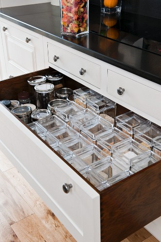 Storage jars in tulipwood kitchen drawer with white front