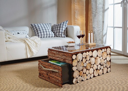 Rustic DIY coffee table clad in bark and slices of log