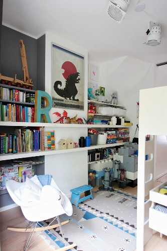 Bunk beds, shelving and classic rocking chair in boys' bedroom