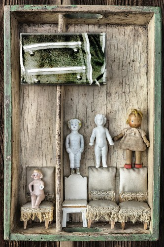 Dolls and dolls' furniture in vintage crate