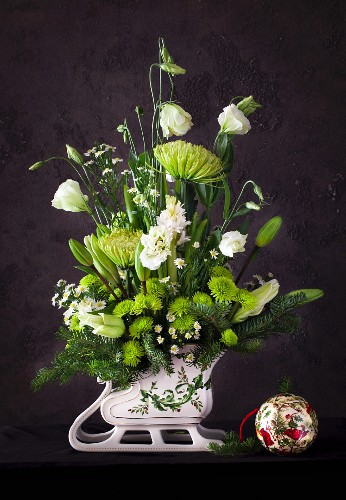Christmas bouquet in sleigh-shaped vase