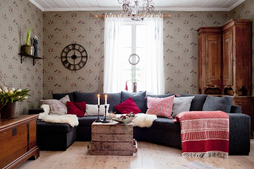 Sofa combination with various scatter cushions and sheepskin blankets in Scandinavian living room