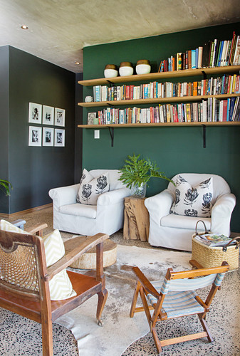 Living room in natural shades with dark green wall