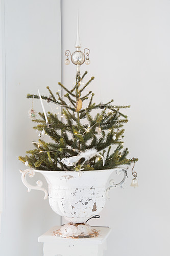 Small Christmas tree with vintage decorations in urn