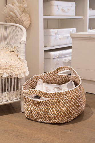 Basket handmade from crocheted jute cord