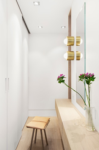 Dressing table on partition wall of walk-in wardrobe in bedroom